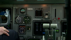 Airplane cockpit view pilot touching buttons Stock Footage