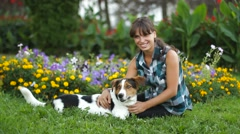 Woman Relaxing With Dog Stock Footage
