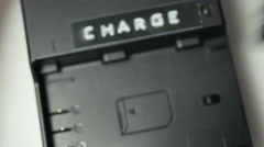 Close up of installing a battery into a charger Stock Footage