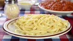 Spooning spaghetti sauce onto pasta Stock Footage
