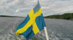 Stern of boat with National Flag of Sweden. Stock Footage