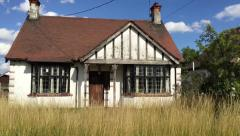 Abandoned English Country Home with unkept lawn Stock Footage