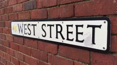 West Street - Sign on a wall in a british town Stock Footage