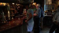 People drinking in a classic British Pub Stock Footage