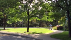 Elderly man sitting beside a garden reflecting on life Stock Footage