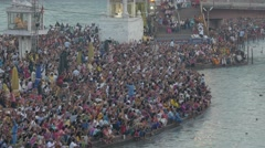 Crowds raise hands during Ganga Aarti at Har-Ki-Pauri,Haridwar,India Stock Footage