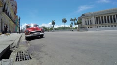 Traffic in the Havana city, old timers at the streets, buildings. Stock Footage