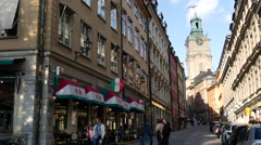 Street in Gamla Stan with the Royal Palace Church in the background Stockholm Stock Footage
