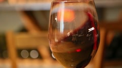 Glass of red wine shaking Stock Footage