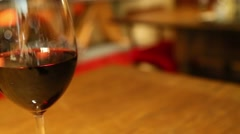 Tracking shot of two wine glasses full of wine Stock Footage