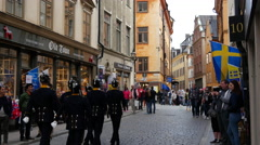 Guards walking in the streets of Gamla Stan Stockholm Sweden Stock Footage