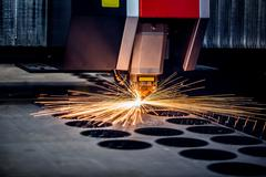 CNC Laser cutting of metal, modern industrial technology. - stock photo