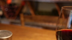 Tracking shot from left to right of two glasses full of red wine Stock Footage