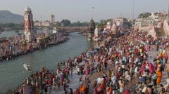 Har-Ki-Pauri with clock tower and pilgrims at Ganga river,Haridwar,India Stock Footage