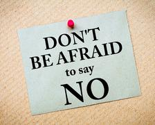 Don't Be Afraid To Say NO Message written on paper note - stock photo
