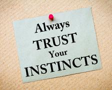 Always Trust Your Instincts Message written on paper note - stock photo
