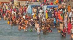Pilgrims bath in Ganga River at Har-Ki-Pauri,Haridwar,India - stock footage