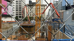 Stock Video Footage of Construction Site Viewed Through Chainlink Fence
