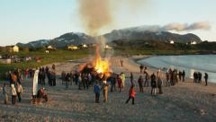 Aerial drone shot of a fire at beachparty Stock Footage