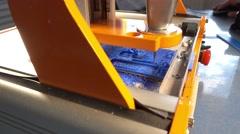 CNC milling machine mills the plastic part Stock Footage