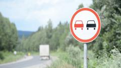 Country summer road. No overtaking traffic sign Stock Footage
