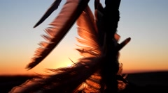 Indian feather ornaments, sunset Stock Footage