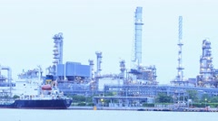 Time lapse oil refinery day to night zoom in Stock Footage