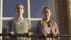 Ballerinas Hold Onto A Railing Like A Ballet Barre, They Are Focused Stock Footage