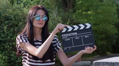 Girl holding clapper board Stock Footage