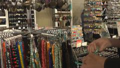 looking at necklaces at market - stock footage