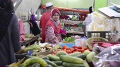 Muslim woman buying vegetables at a dry market Stock Footage