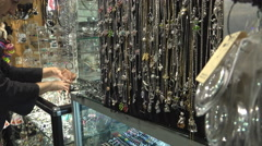 Necklaces on display at market - stock footage