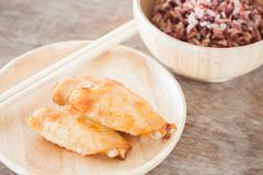 Grilled chicken wings with multi grains berry rice Stock Photos