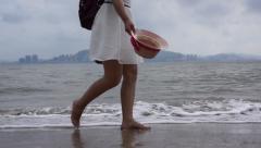 Girl walking on beach bare feet Stock Footage