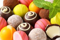 Assorted chocolate truffles and fruit ganache pralines - stock photo