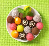 Assorted chocolate truffles and fruit ganache pralines Stock Photos