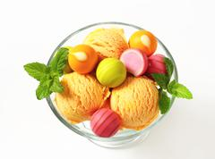 Stock Photo of Fruit-flavored ice cream and white chocolate bonbons in a coupe