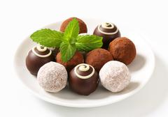 Delicious chocolate truffles with  ganache filling - stock photo