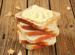 Slices of sandwich bread and butter - stock photo