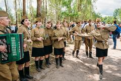 Artists dressed as Soviet Russian soldiers dance during events Stock Photos