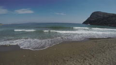 sea surf on a hot Sunny day on the sandy beach against a backdrop of hills and h - stock footage