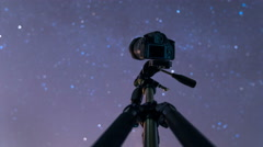 4 in 1 video! Camera shoot time lapse of the sky with stars above forest Stock Footage