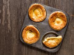 Rustic golden british yorkshire pudding Stock Photos