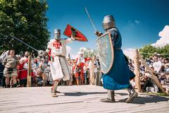 Knights In Fight With Sword. Restoration Of Knightly Battle Kuvituskuvat