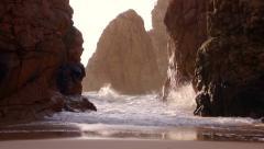 Rocks and Surf Backlit Sun - stock footage