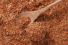 Brown flax seeds background - stock photo