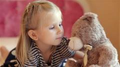 Adorable little girl hugging her bear Stock Footage