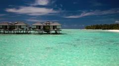 View of the over water villas and tropical island Stock Footage