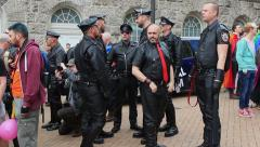 Fetishism - group of men in leather suits during gay pride Stock Footage