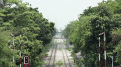 Long-lens shot from above of railway lines converging in distance on hot hazy - stock footage